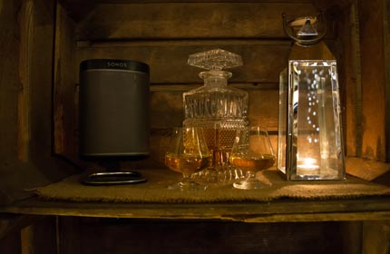 Relax with soft candle lighting, a warming tumbler of Whiskey and great music playing on the Sonos