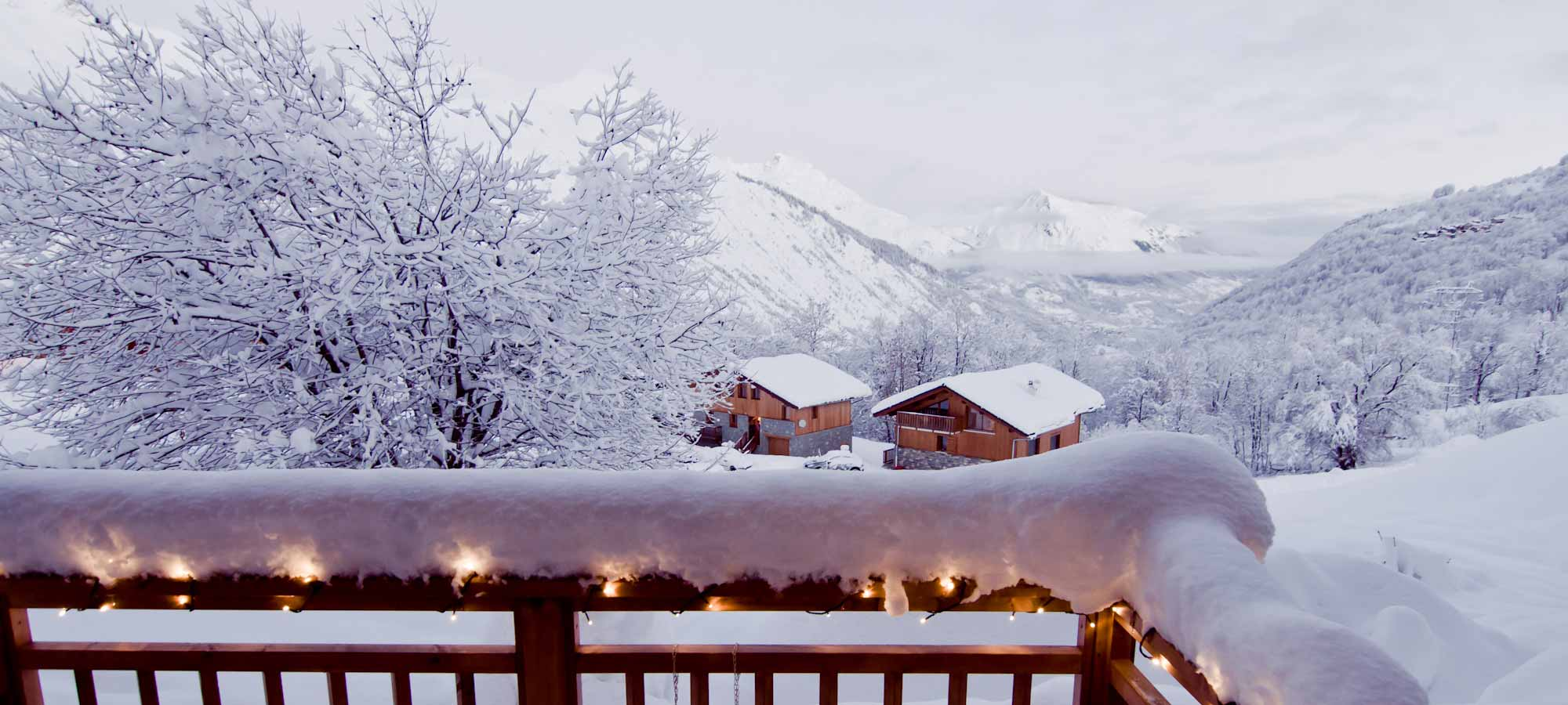 A beautifully snowy terrace with stunning views of the Belleville valley